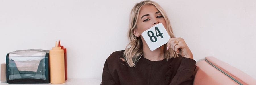woman with number over face