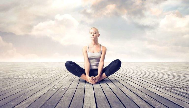 Woman Meditating on Dreamy Parquet Floor With Clouds