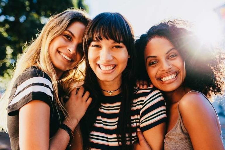 3 Young Woman Smiling in a Selfie