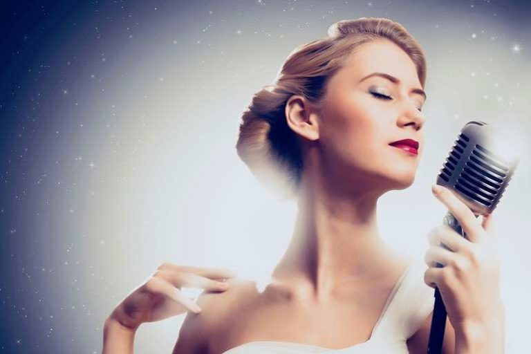 Woman Performer with 1940s hair & vintage microphone