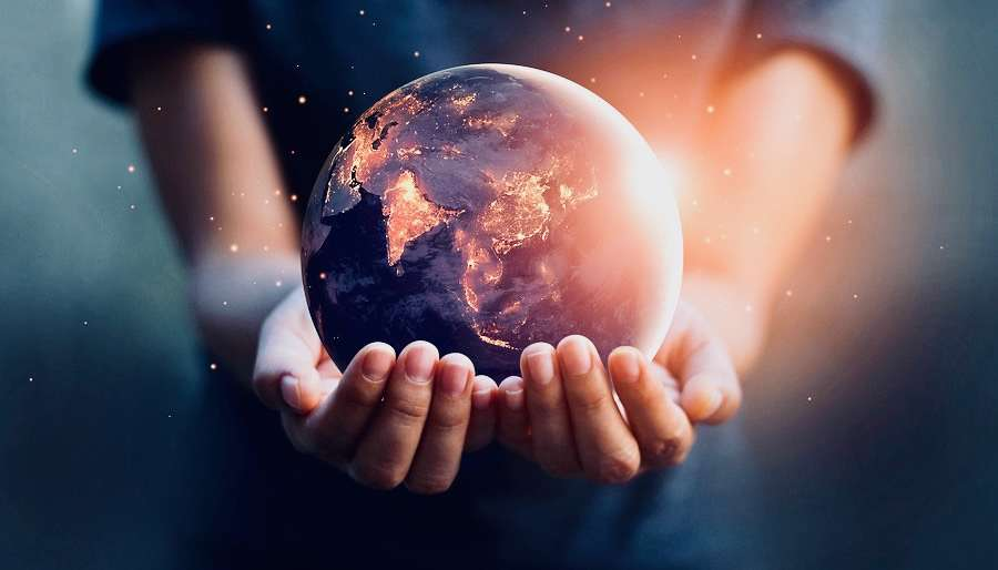 Hands Holding Earth Glowing
