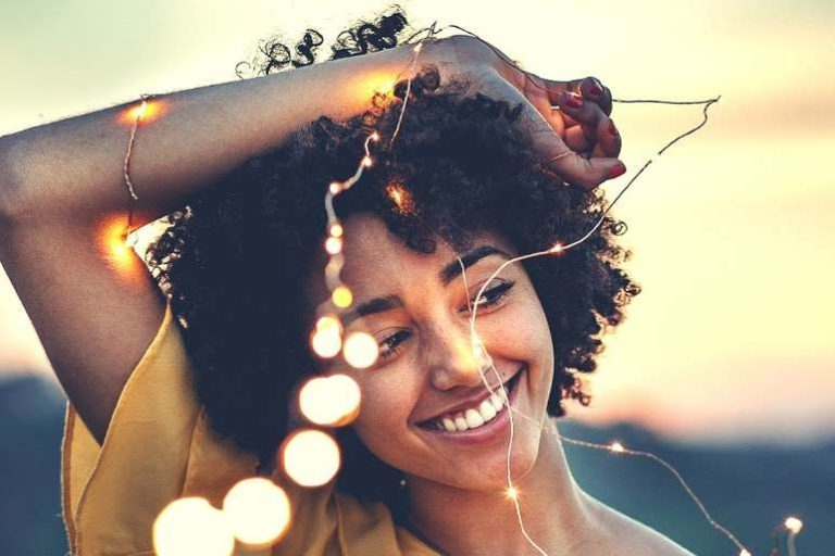 Woman Smiling with Fairy Lights