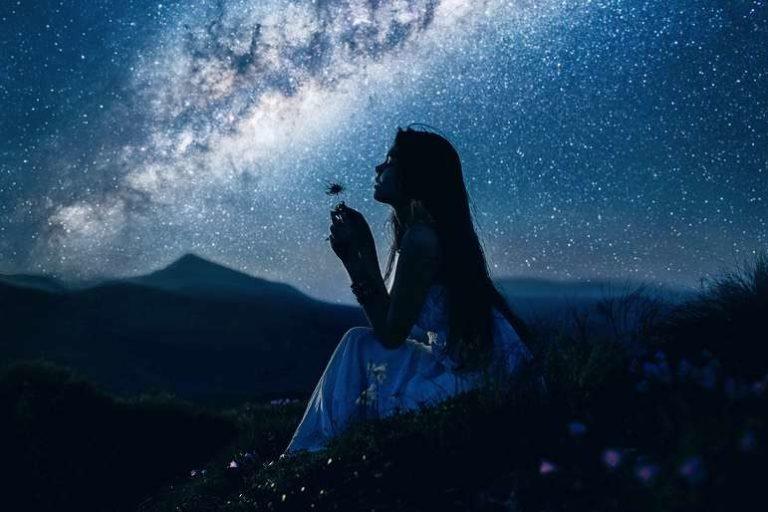 Girl Blowing Dandelion Under Milky Way Galaxy Sky