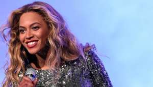 Beyonce Knowles in Sequin Dress On Stage Head Shot