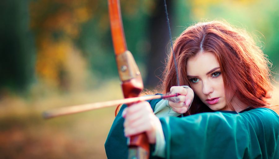 Red Haired Woman Archer Shooting Bow & Arrow