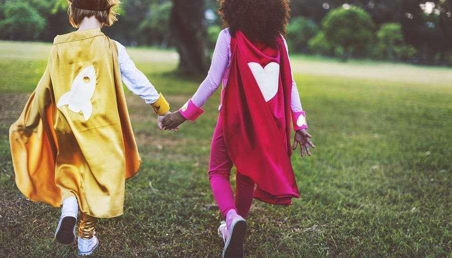 Best Friends CHildren Wearing Superhero Capes