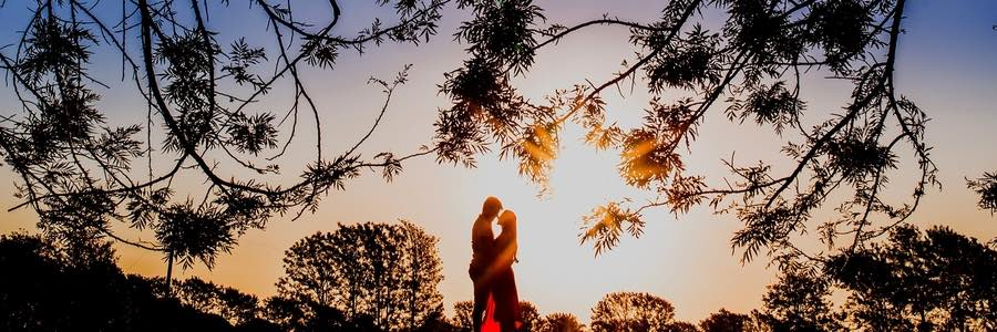 Couple Embracing, love in a tropical skyline