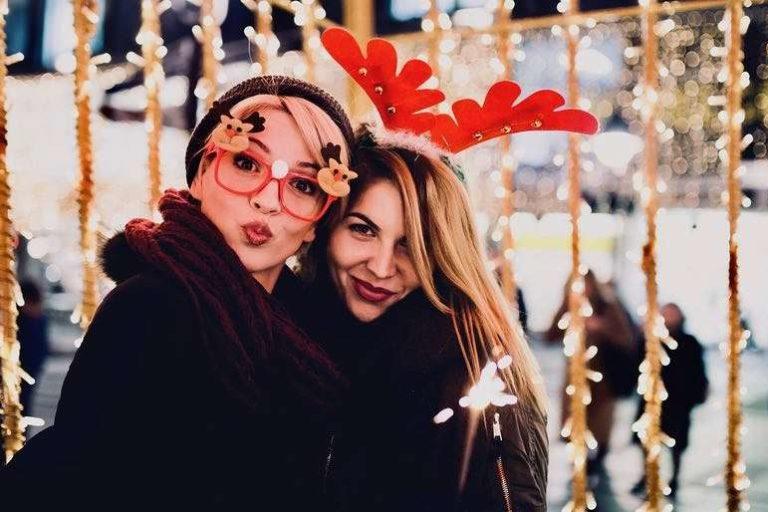 Two Female Friends Outside Celebrating Christmas