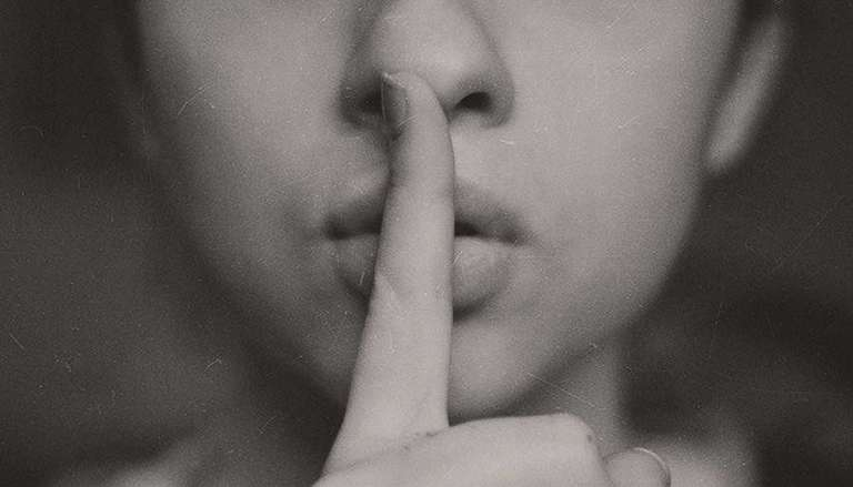 Shhh - Finger in Front of Lips Signalling Quiet.