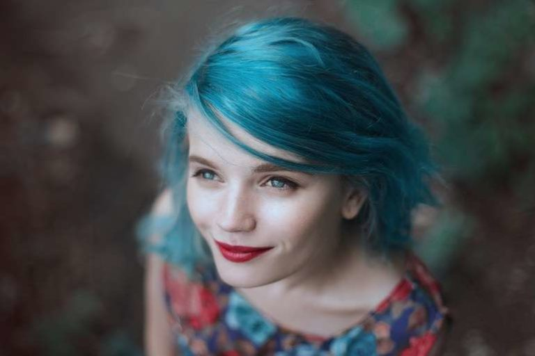Girl looking up with blue hair & red lipstick