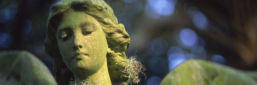 Green Mossy Face of Statue of Archangel Ariel
