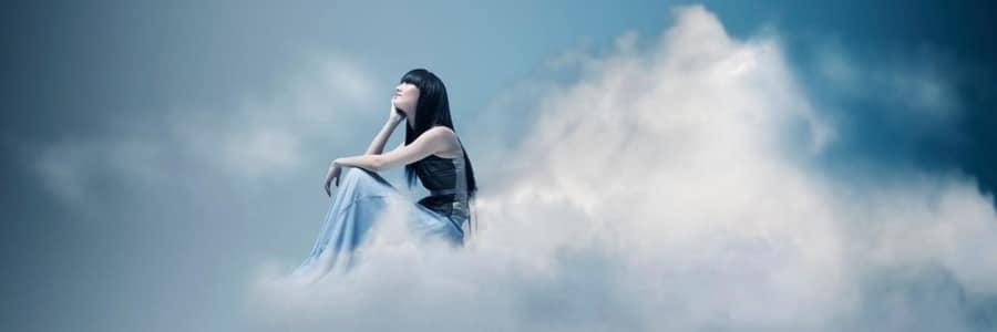 Archangel Gabriel Sitting on top of Clouds Gazing Upward