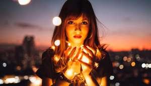 woman holding golden lights