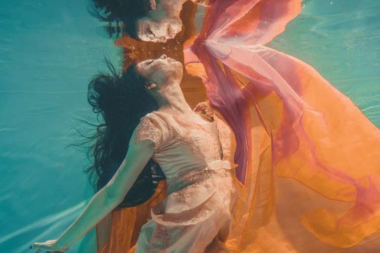 Woman Underwater in Floaty Orange Dress
