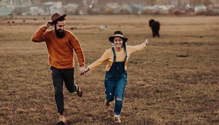 Couple Running Free at a Festival - Sagittarius Love