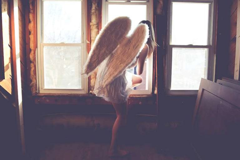 pink feather angel sign