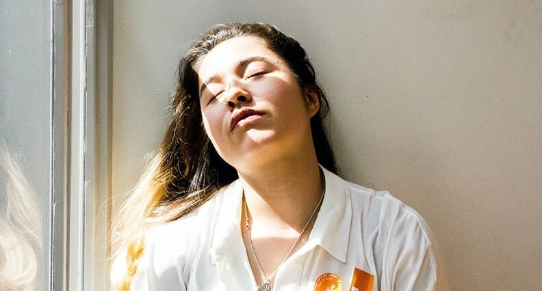Girl sitting in the sunlight